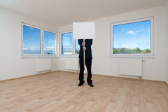 Man holding sign in empty room Stock Image
