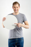 Man holding sign. Smiling young man holding blank sign in hands Stock Image