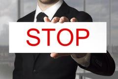 Man holding sign stop Stock Photos