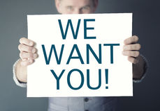 Man holding sign with words We Want You Royalty Free Stock Photography