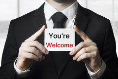 Man holding sign you are welcome Stock Images