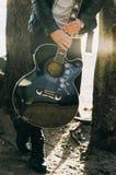 Man Holding Single Cutaway Acoustic Guitar Stock Image