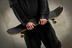Man Holding Skateboard Stock Photography