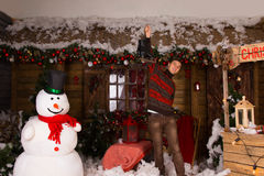 Man Holding Skates Up at Christmas Decorated House Stock Images