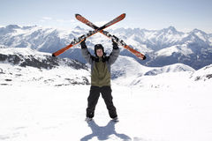 Man holding skis up Royalty Free Stock Photography