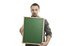 Man holding a small blackboard in the hands Royalty Free Stock Images