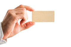 Man holding a small blank wooden block Stock Photos