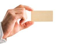 Man holding a small blank wooden block Stock Photos
