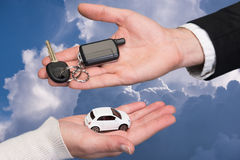 Man holding small car key, woman holding small car Royalty Free Stock Images