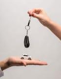 Man holding small car, woman holding car key Stock Photography