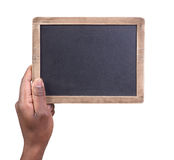 Man holding a small chalkboard Stock Image