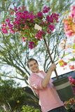 Man holding small flowering tree in pot Royalty Free Stock Photos