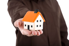 Man holding a small house Stock Photography