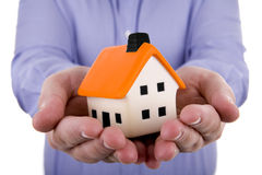 Man holding a small house Royalty Free Stock Photo