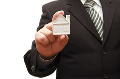 Man holding a small house in his hand Stock Photos