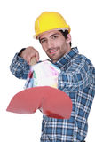Man holding a small house Stock Image