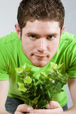 Man holding small plant Stock Photography
