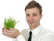 Man holding a small plant Stock Photography