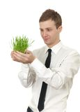 Man holding a small plant Stock Image
