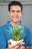 Man Holding Small Plant Royalty Free Stock Photo