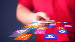 Man holding smart phone with colorful application icons. Comming out Stock Image