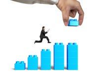 Man holding smart tablet running bar graph block hand building Stock Images