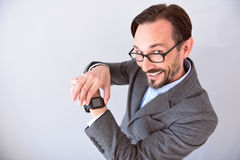 Man holding smart watch on his wrist Stock Image