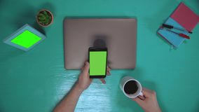 Person using mobile top view stock video