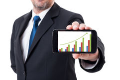 Man holding smartphone with growing financial chart Stock Photos