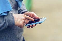 Man holding smartphone. Stock Image