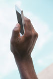 Man holding smartphone in hand Royalty Free Stock Photography