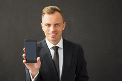 Man holding smartphone Stock Images