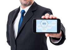Man holding smartphone with SEO diagram Stock Photos