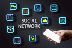Man holding smartphone with social network concept. Royalty Free Stock Photography