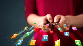 Man holding smartphone with technology application icons. Comming out Royalty Free Stock Photography
