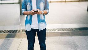 Man holding a smartphone. using cell phone on lifestyle. stock photo