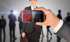 Man holding smartphone with x-ray of woman Stock Photography