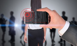 Man holding smartphone with x-ray of womans back Stock Photo