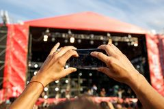 Man holding smartphones in hands and photographing. Taking photo on front stage on summet. Stock Image