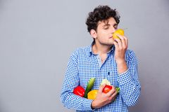 Man holding smelling vegetables Stock Images