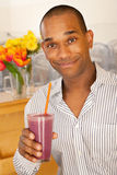 Man Holding a Smoothie Stock Photography