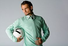Man Holding Soccer Ball Royalty Free Stock Photography
