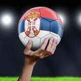 Man holding Soccer ball with Serbian flag. Image of Man holding Soccer ball with Serbian flag stock photos