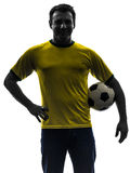 Man holding soccer football silhouette Stock Images