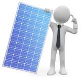 Man holding a solar panel Stock Photos