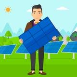 Man holding solar panel. Stock Photos