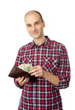 Man holding some dollars. Man taking out money from the wallet Royalty Free Stock Photo