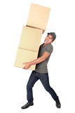 Man Holding some heavy Stack Of Cardboard Boxes Royalty Free Stock Image