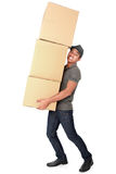 Man Holding some heavy Stack Of Cardboard Boxes. On White Background stock images