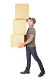 Man Holding some heavy Stack Of Cardboard Boxes. On White Background royalty free stock photos
